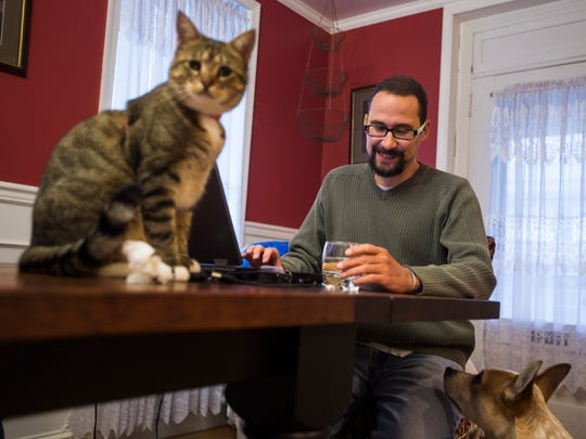 Jason Ewen, 42, works at his computer Wednesday evening Dec. 2, 2015 while at home with his family and two pets, June, left, and Brunson, right, an 8 year-old Australian Cattle and Miniature Poodle mix. Ewen, a resident of Littlestown, suffers from a heart condition known as d-transposition of the great arteries and is currently on a list to receive a heart transplant. Ewen and his wife, Ellen, are currently fundraising for Jason's heart transplant through the National Foundation for Transplants.
