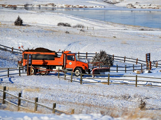 A Cascade County snow plow plows along Giant Springs road near the Rainbow Dam overlooks in December.