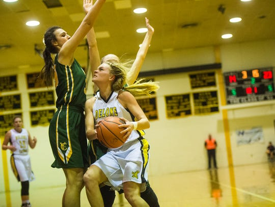 Delone's Katie Laughman braces against York Catholic