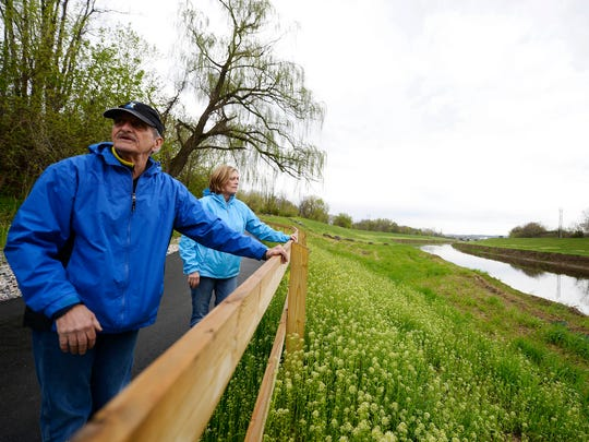 Joe and Jackie Haberle of York walk the new section of the Heritage Rail Trail County Park.