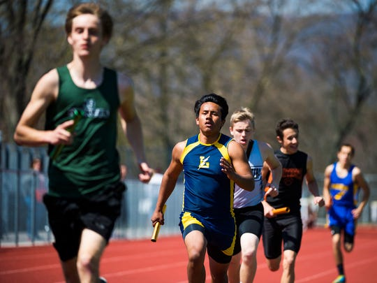 Littlestown's José Ariza competes in the boys' 3,200-meter relay on Saturday at Northern High School during the Arctic Blast Track and Field Invitational.