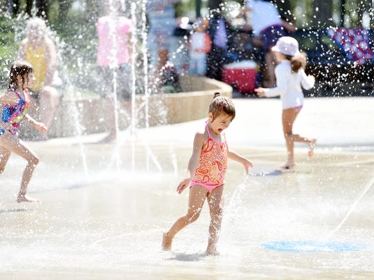 Maddie Aungst, 4, of Marietta, plays at the splash pad in Red Lion's Fairmount Park.