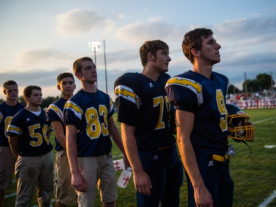 Littlestown's Malachi Fodor (70) stands with teammates