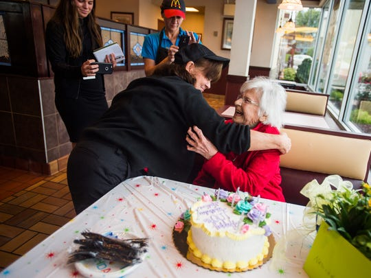 Nadine Baum is congratulated by McDonald's employee Ginny Slaubaugh on Thursday Oct. 13, 2016 while celebrating her 100th birthday party at the south Hanover McDonald's. Baum celebrates her birthday every year at the restaurant with her son Mike baum.