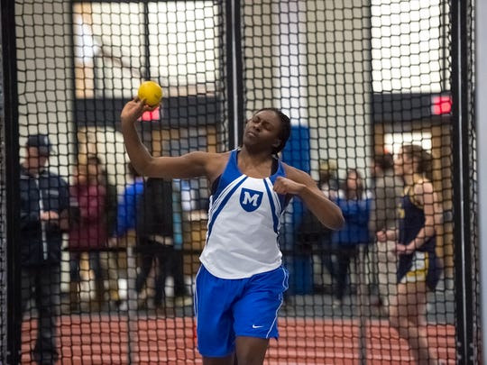 Mercersburg Academy's Isiuwa Oghagbon throws the shot put during a track and field invitational in Hale Field House at Mercersburg Academy on Friday, Jan. 27, 2017.