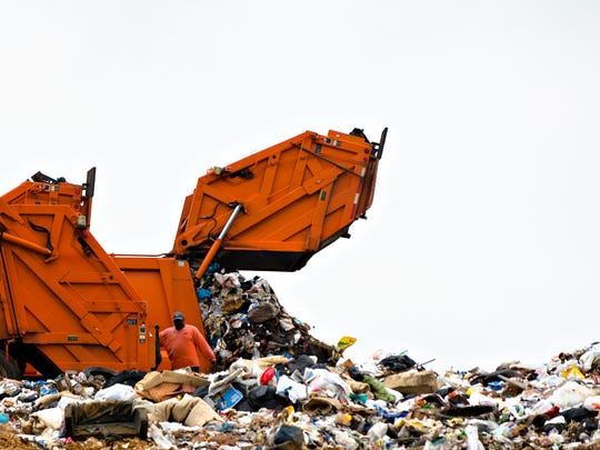 City employees unload their garbage trucks at the city landfill on Tuesday, March 7, 2017, in Montgomery, Ala. The city's recycling facility, previously operated by IREP, closed in Oct. 2015 leaving the city without residential recycling.