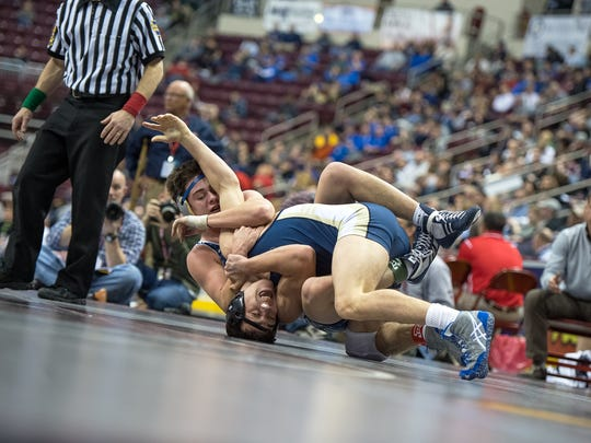 Chambersburg's Luke Nichter, top, pulls Collin Hurley of W.C. Rustin toward his back in a 160-pound bout during PIAA Wrestling Championships on Thursday, March 9, 2017 at Giant Center in Hershey, Pa. Nichter won by major decision, 11-1.