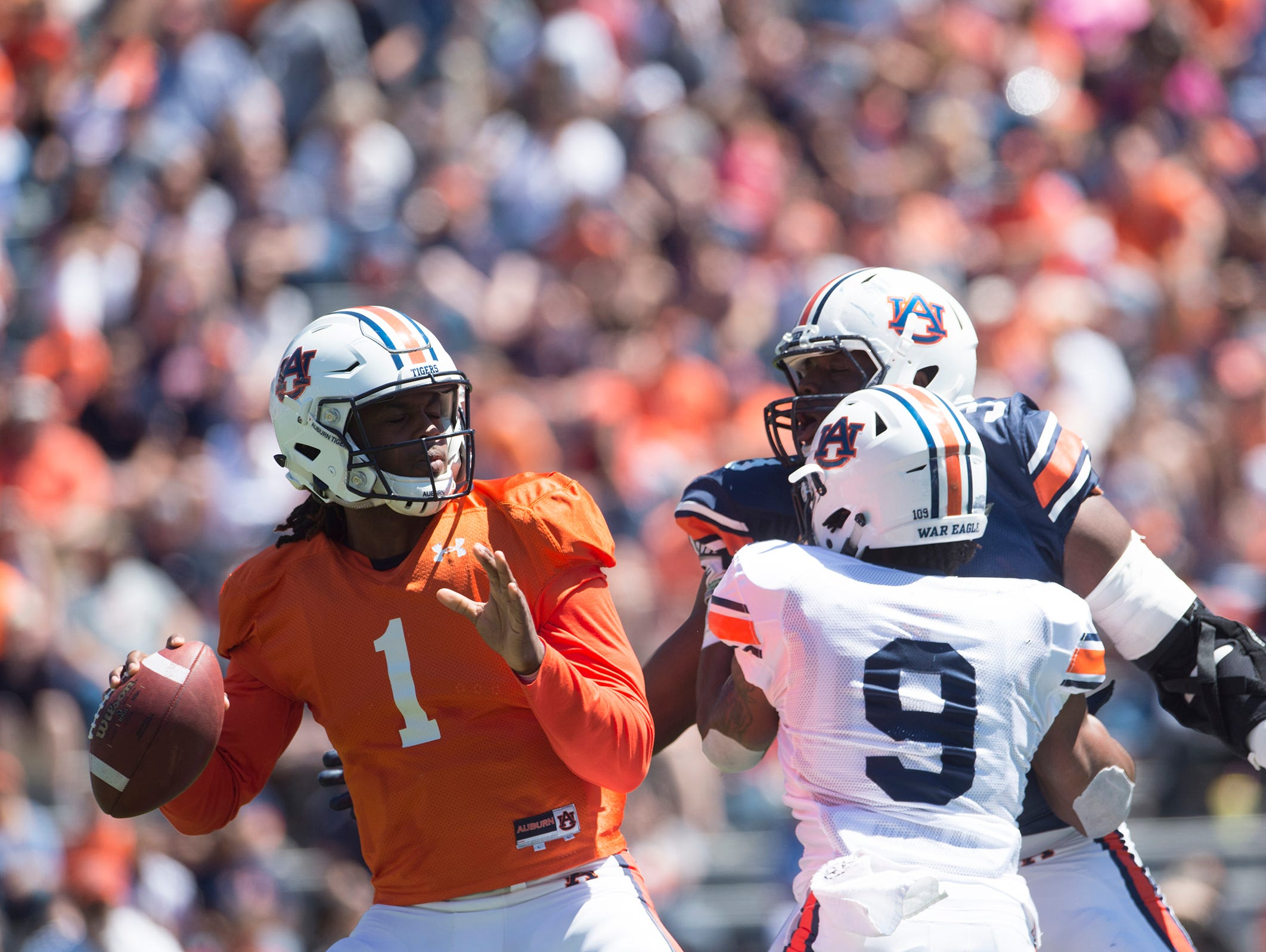 Auburn quarterback Woody Barrett (1) looks to throw a pass as Auburn defensive lineman Marlon Davidson (3) looks to sack him during Auburn's A-Day on Saturday, April 8, 2017, at Jordan Hare Stadium in Auburn, Ala.