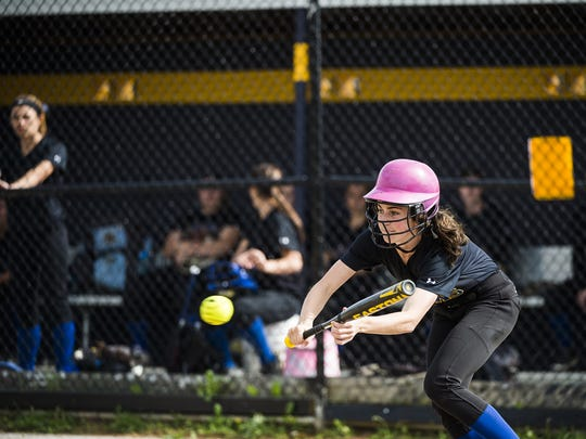 Kennard-Dale's Madelyn Miller bunts the ball against