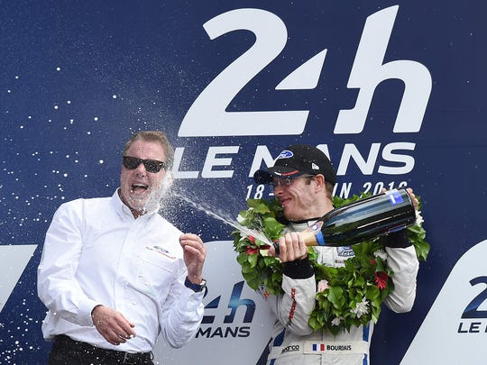 Sebastien Bourdais sprays champagne onto William Clay Ford Jr., Executive Chairman of Ford Motor Company, after Bourdais and fellow drivers Joey Hand and Dirk Mueller celebrate winning the LMGTE PRO category with their Ford GT of the 84th Le Mans 24-hours endurance race on June 19, 2016 in Le Mans, France.