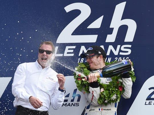 Sebastien Bourdais sprays champagne onto William Clay