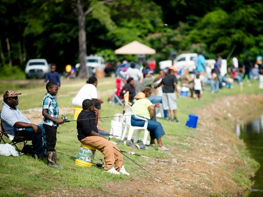 Hery Mcintyre fishes with other children during the Montgomery Sheriff's Kids Fishing Rodeo on Saturday, June 17, 2017, at the at the Montgomery County fishing ponds in Montgomery County, Ala.