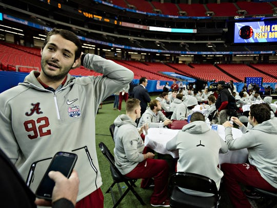 Alabama place kicker Andy Pappanastos (92) speaks to members of the media during the Peach Bowl Media Day event at the Georgia Dome in Atlanta, Ga., on Thursday, Dec. 29, 2016.