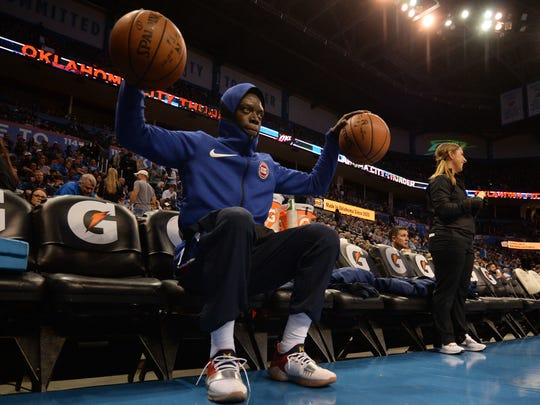 Pistons guard Reggie Jackson (1) warms up prior to