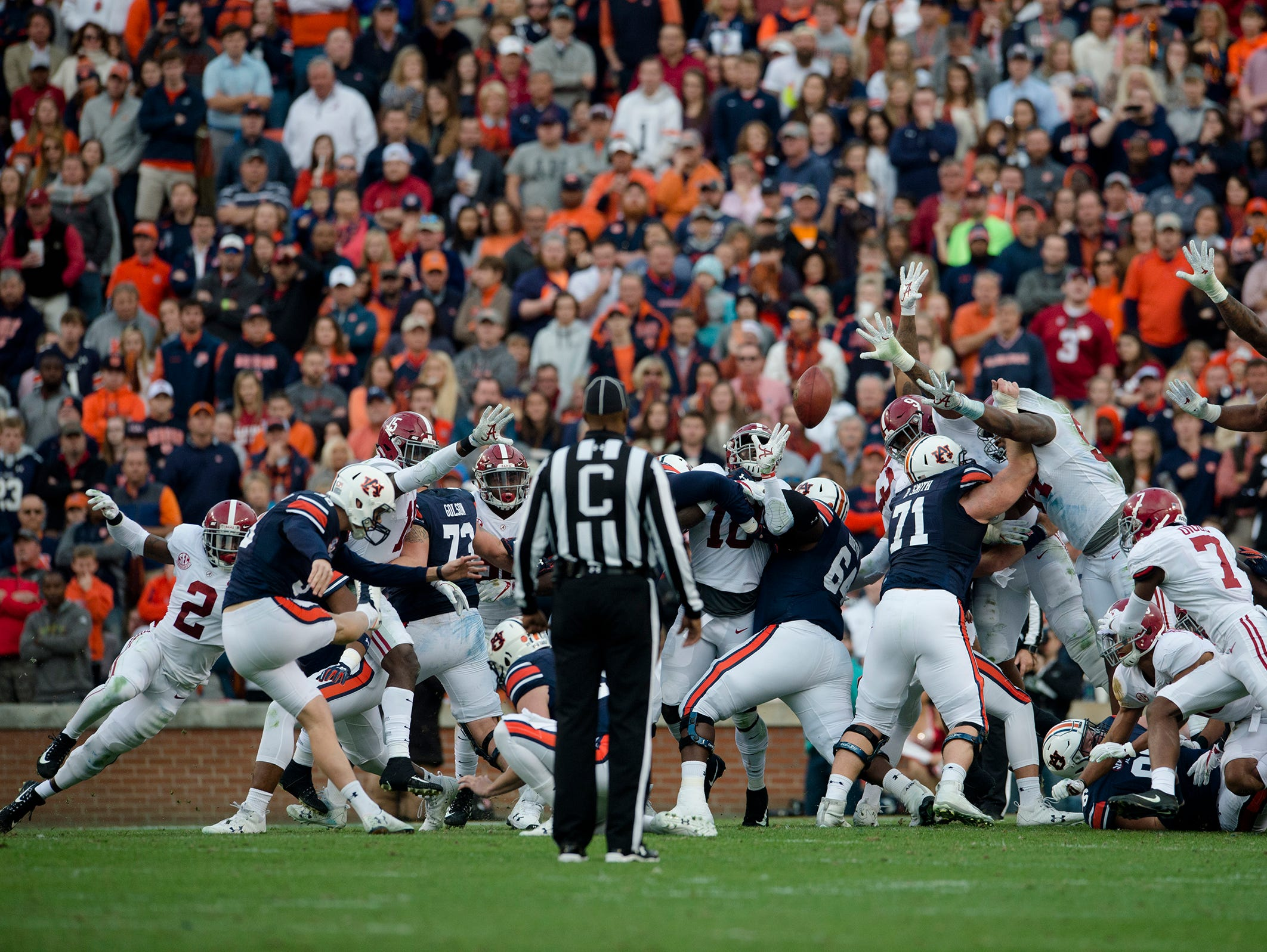 Auburn place kicker Daniel Carlson (38) hits a field goal at halftime to put Auburn up on Alabama 10-7 during the Iron Bowl NCAA football game between Auburn and Alabama on Saturday, Nov. 25, 2017, in Auburn, Ala.