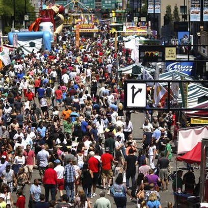Thousands gather at the Taste of Cincinnati on Fifth