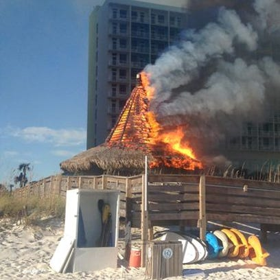 A fire destroys the Riptides Sports Bar on the Holiday Inn Pensacola Beach Resort pool deck Friday afternoon.