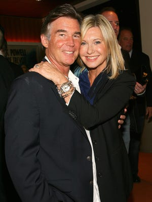 John Easterling and Olivia Newton-John on Oct. 24, 2011, in Hollywood.