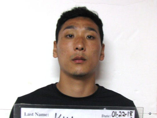 Byong Oh Kim is shown in his booking mugshot at the