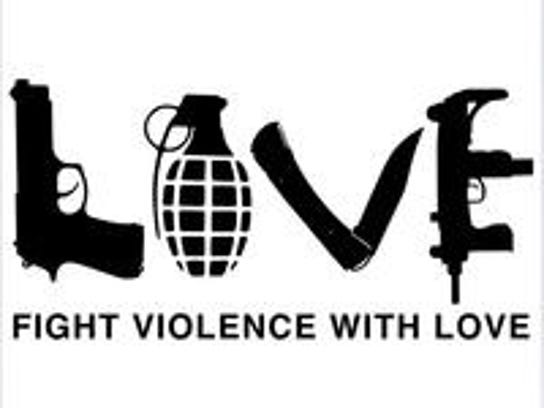 "Thomas Deininger, a Rhode Island artist who created this design, has added ""Fight Violence with Love"" to his new website so people won't misinterpret the meaning, like he thinks has happened in a dispute over banning a knock-off version of the shirt at Markesan High School."