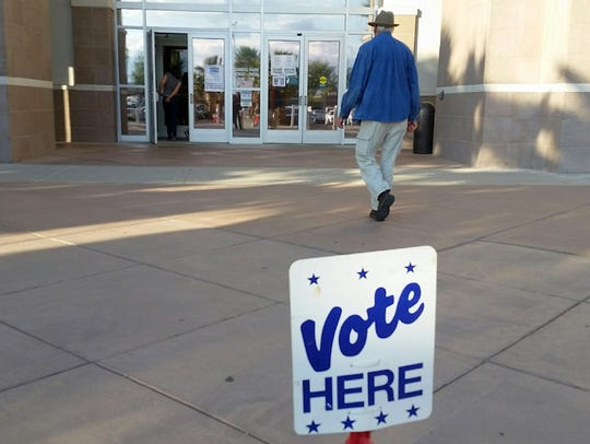 "A ""Vote Here"" sign outside of the Doña Ana County Government"
