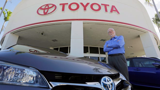In this Friday, Feb. 10, 2017, photo, Earl Stewart, owner of a Toyota dealership, poses for a photo at his business in North Palm Beach, Fla. Stewart advises people to ignore dealer advertising.