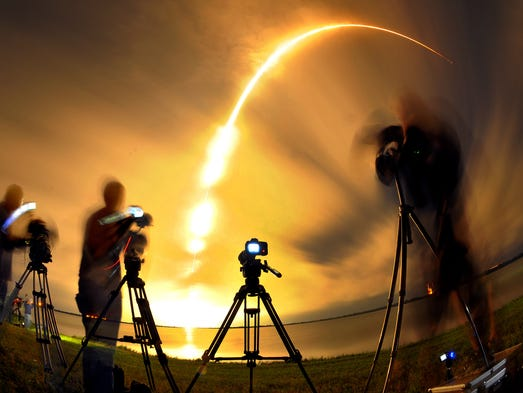 The media covers a Space X falcon 9 rocket carrying the AsiaSat 8 Satellite turn night into day during a 4am liftoff early Tuesday morning from the Cape Canaveral Air Force Station .