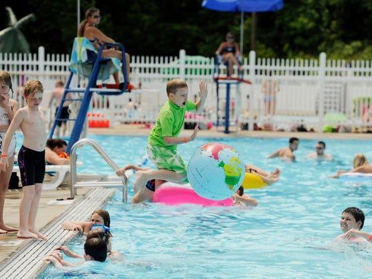 Devin Singer, 11, cools off in the pool at Burdette Park in Evansville.
