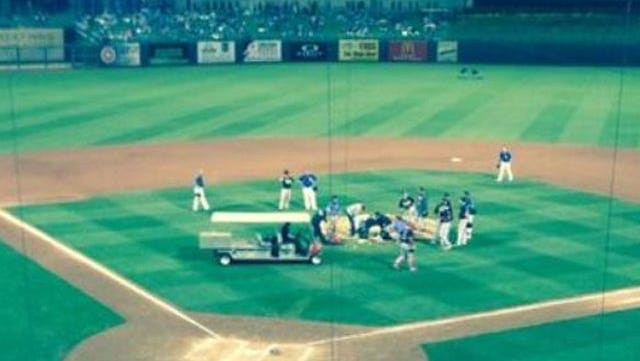 The scene at Surprise Stadium after Reds closer Aroldis Chapman was struck by a line drive Wednesday night.