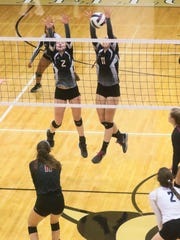 T.L. Hanna's Meredith Hollinger, right, blocks a spike near teammate Gabby Easton against Rock Hill Tuesday.