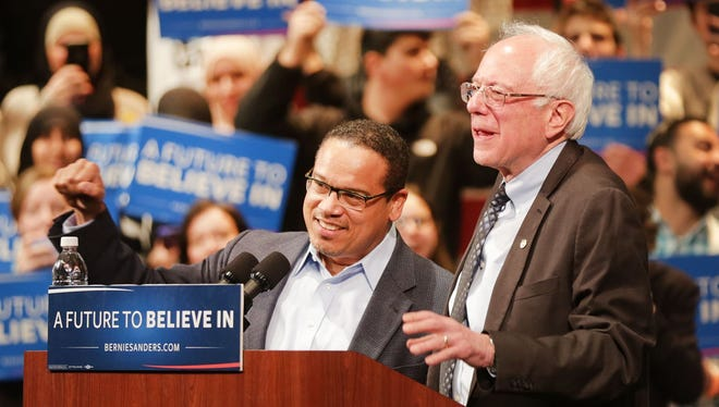 Detroit native Congressman Keith Ellison, a U.S. Representative from Minnesota, left, introduces presidential candidate Bernie Sanders  to a crowd of supporters at the Michael A. Guido Theater in Dearborn  Monday, March 7, 2016.