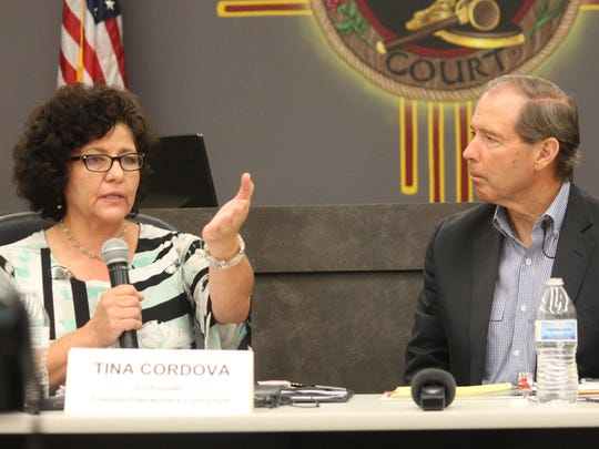In this file photo from July 2015, Tularosa Basin Downwinders co-Founder Tina Cordova speaks to Sen. Tom Udall about the group's belief that the Trinity test changed the gene pools of residents in surrounding communities.
