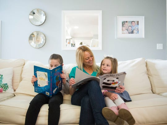 Amanda Nerstad reads with her daughters, Isabella,