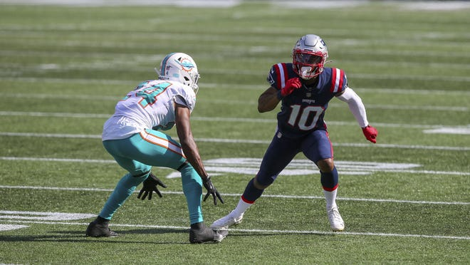 Patriots wide receiver Damiere Byrd, right, is defended by Miami Dolphins cornerback Byron Jones during the second half of the game Sept. 13 in Foxboro.