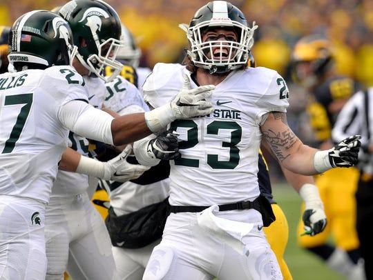 MSU's Chris Frey celebrates a stop against Michigan