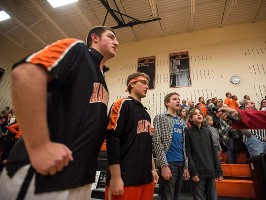 Hanover varsity basketball players perform the National Anthem on Jan. 5 before their game against York Catholic.