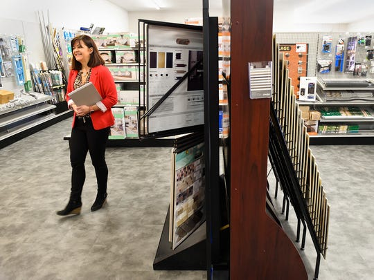 Barb Brandes, co-owner of Lumber One, shows the expanded and remodeled showroom area Tuesday, March 21, in Avon. More products are on display, including flooring and tools.
