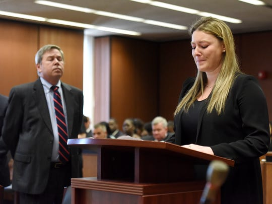 Assistant Essex County Prosecutor Brian Matthews looks on while Jamie Share Friedland, widow of Dustin Friedland, describes the life that was torn from her when Basim Henry murdered her husband in 2013 at the Mall of Short Hills. Henry was sentenced to life in prison for the 2013 murder, plus ten years for possession of a weapon by a felon. Henry was sentenced by Judge Michael Ravin in Essex Superior Court on Monday, June 26, 2017.