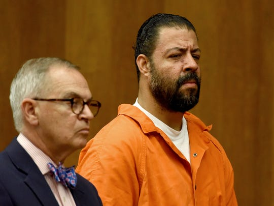 Raphael Lolos, beside his attorney, Brian Neary, pleaded not guilty on July 12 to the killing of his girlfriend, Jenny Londono, 31, of Edgewater.