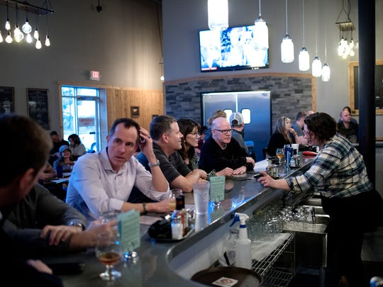 Patrons drink Old Nation Brewing Company beer on Wednesday, Feb. 28, 2018, in Williamston.