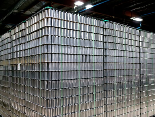 Palettes of empty M-43 cans are stored at the Old Nation