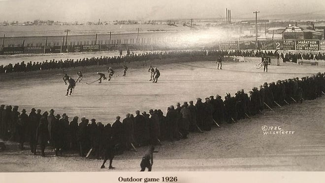 "A photo from the book, ""The Wausau Vets and the early days of Wausau hockey"" shows a crowd gathered at a Wausau outdoor rink in 1926"