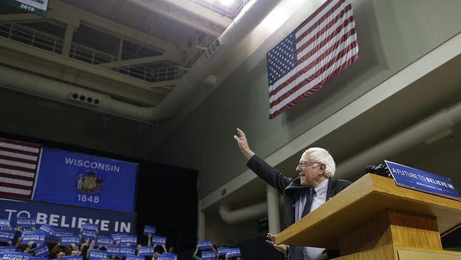 Democratic presidential candidate Bernie Sanders waves to the crowd before speaking during his campaign stop at UW-Green Bay on Friday, April 1, 2016.