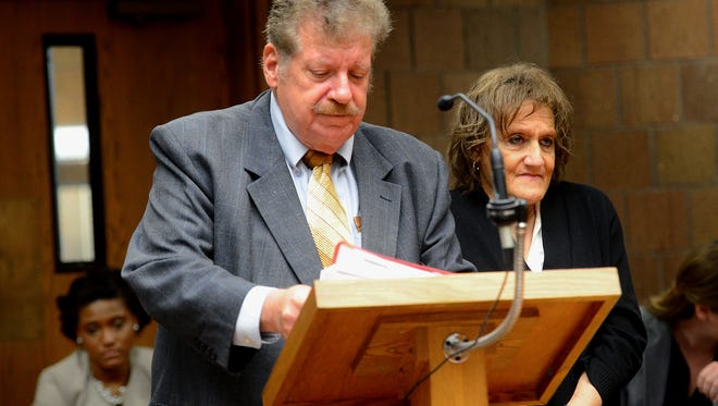 Lannie Price stands with her attorney, Richard Williams, Thursday, September 24, 2015, in 55th District Court in Mason. She and her daughter, Amanda Price, pleaded no contest in Ingham County Circuit Court to charges stemming from 126 cats being removed last year from the Lansing Township home where they lived.