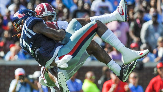 Ole Miss wide receiver Damore'ea Stringfellow makes a catch against Alabama defensive back Marlon Humphrey in Saturday's game.