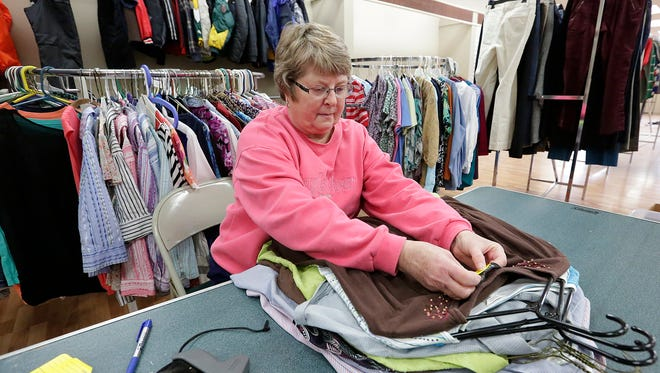 Kris Sebert places price tags on womens clothing at Second Impressions. A new thrift store opening up at 325 Winnebago Drive in Fond du Lac. Doug Raflik/USA TODAY NETWORK-Wisconsin