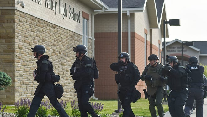 a SWAT team enters the front doors of River Valley High School shortly after first arrivers entered to engage a simulated school shooter. While the threat was merely a simulation and training exercise, it was an important way for law enforcement and emergency services to prepare for a real life active shooter situation.
