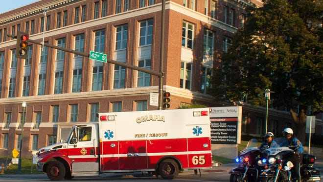 An ambulance transports Ashoka Mukpo, who contracted Ebola while working in Liberia, to the Nebraska Medical Center's specialized isolation unit Monday, Oct. 6, 2014, in Omaha, Neb. He recovered and was released from the hospital last month.