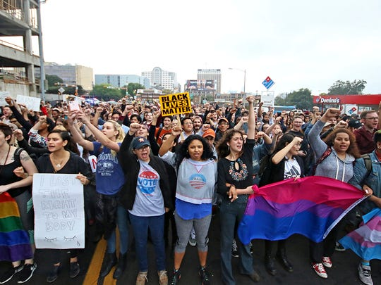 Students at the University of Texas at Austin lead a protest down to Congress Bridge Wednesday, Nov. 9, 2016, in Austin, Texas. Hundreds of University of Texas students march through downtown Austin in protest of Donald Trump's presidential victory.