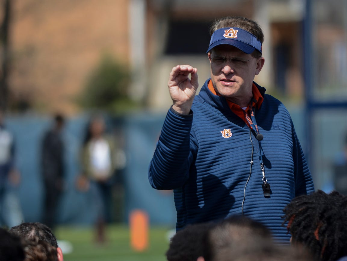Auburn head coach Gus Malzahn speaks to the team during spring football practice on Saturday, March 4, 2017 in Auburn, Ala.